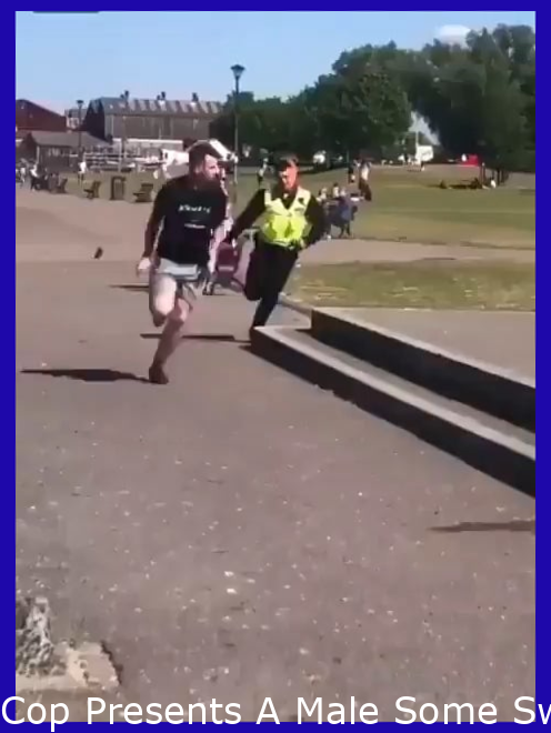 Cop Gives A Man Some Swimming Lessons