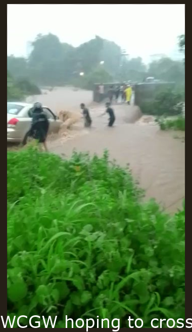 WCGW trying to cross a flooded overpass