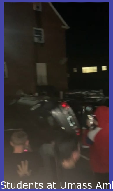 Students at Umass Amherst flip a car that belongs to a frat house over sexual assault allegations.